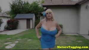 Busty mature gives a wild handjob