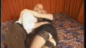 Blonde girl is wearing a teddy and getting spanked from the back while moaning from pleasure