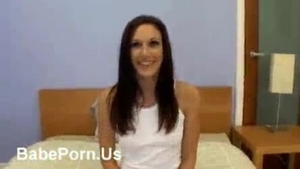 Lovely brunette girl in short skirt is showing her tits to her lover, on the webcam