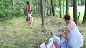 Young and old girls having a threesome outdoors